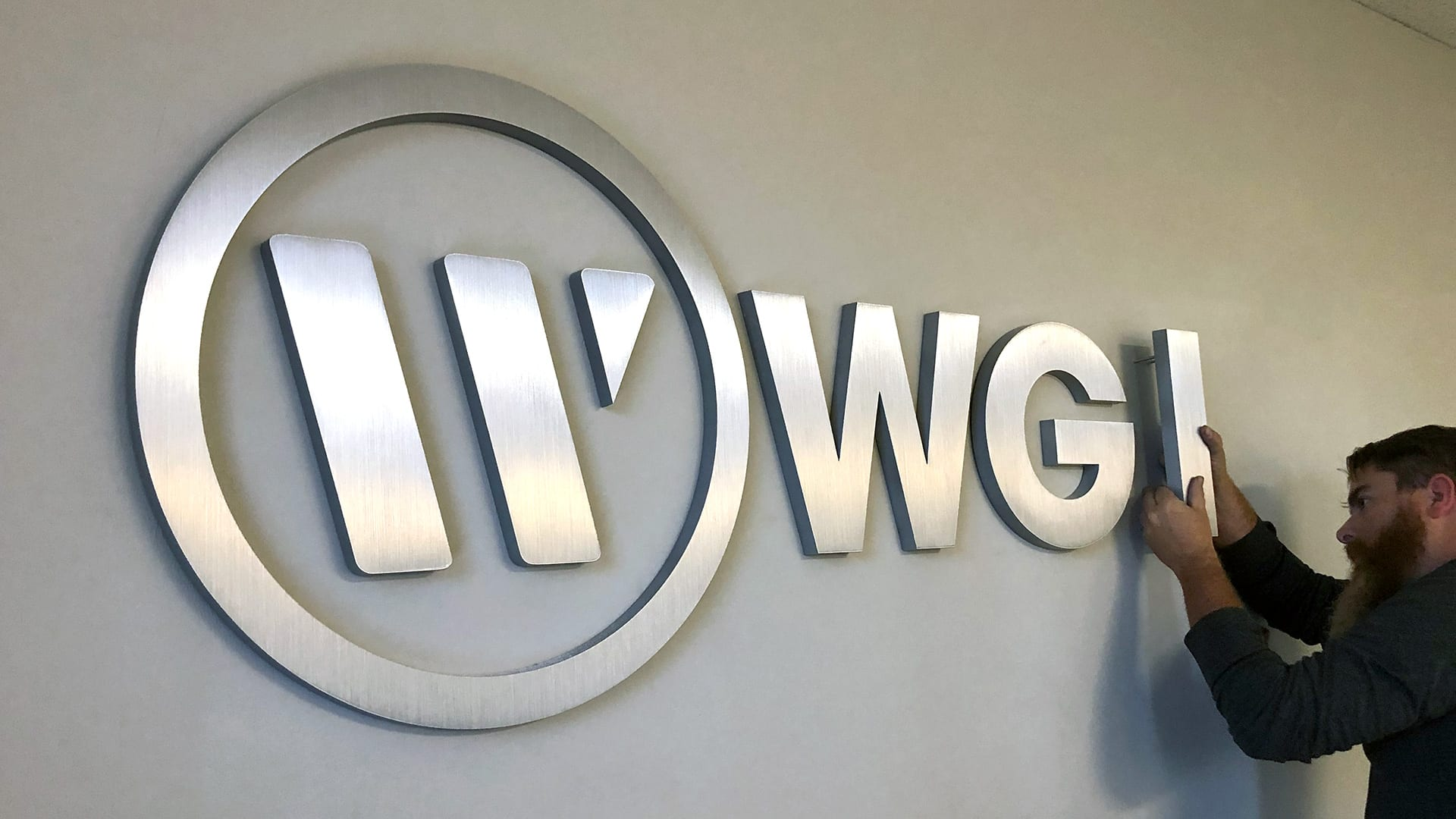 WGI logo sign installation