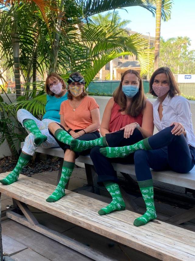 YES Week - WPB ladies in socks